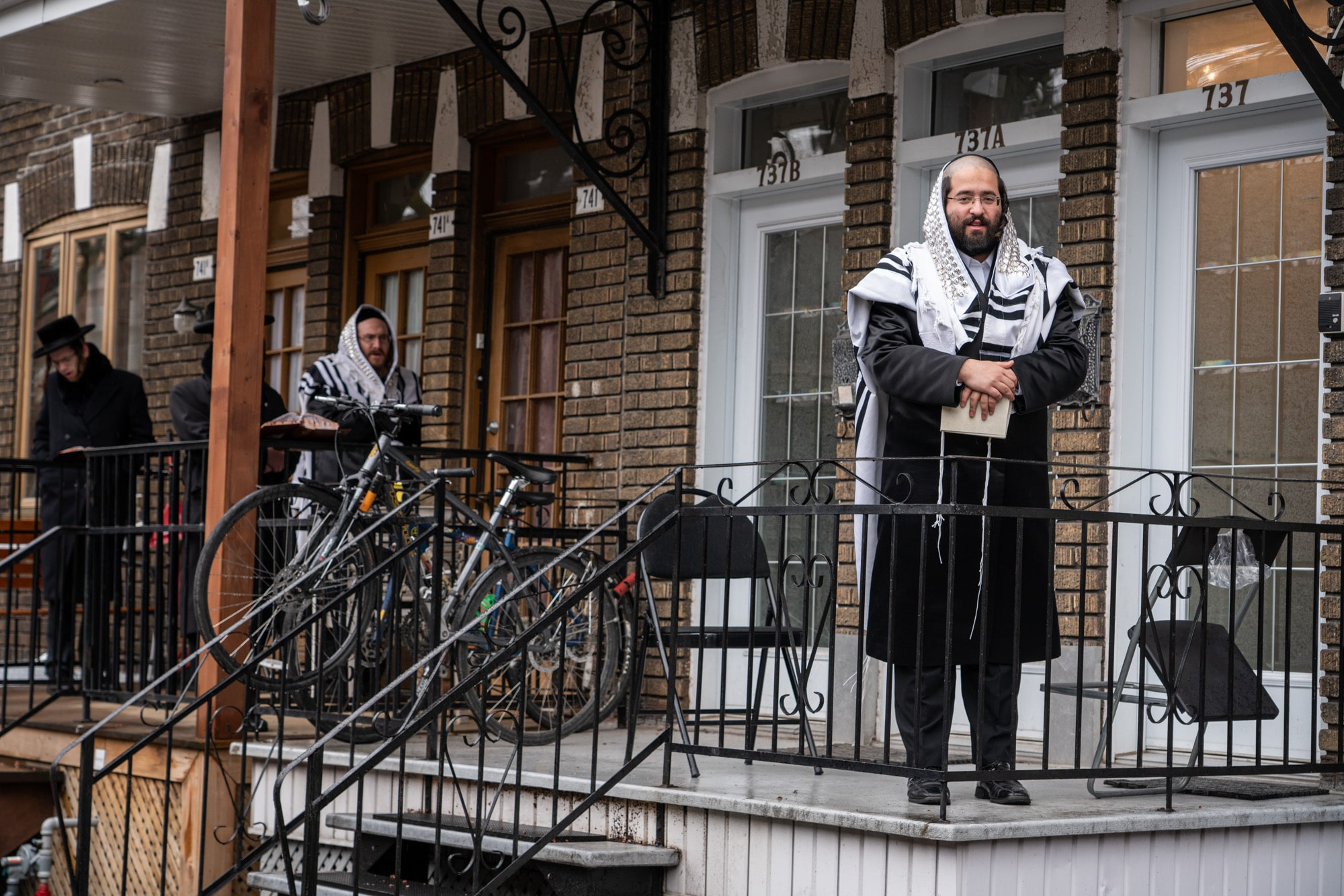 April 10, 2020 -Montreal, Canada : Hasidic Jews pray outside during Passover following the public health directive of social distancing. The directive prohibits any gathering and all places of worship for all religions have been ordered to close.The Hasidic communities have been particularly affected by the COVID-19 pandemic.Their close ties with communities in New York could be one of the reasons.(Eric Demers/Polaris)